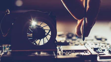 Photo pour Computer part repair. Closeup of disassembled motherboard. Engineer fixing pc components. - image libre de droit