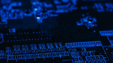 Photo for Printed circuit board. Electronics science. Blue glowing contact pads on black PCB. - Royalty Free Image