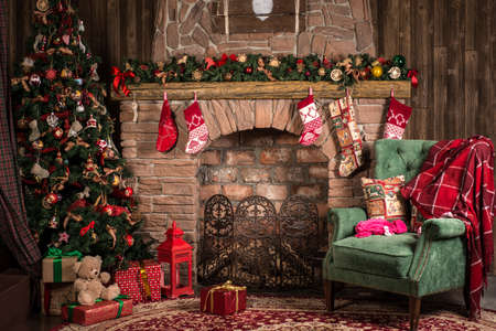 Photo for Interior Christmas room: fireplace, chair and tree - Royalty Free Image