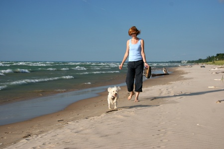 Woman and Small Dog Walking on the Beach - Pinery Provincial Park, Lake Huron, Ontario