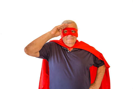 soldier saluting by old man wearing superhero costume with red cape and maskの写真素材