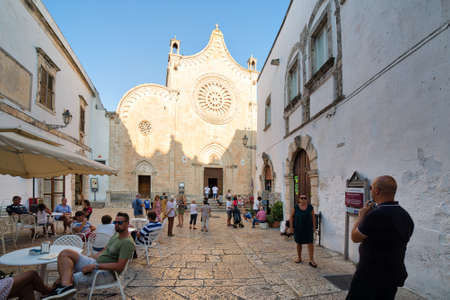 OSTUNI (BR), ITALY - AUGUST 29, 2016: The mayor issued the Ordinance to whitewash the facades of the houses with lime milk to keep the historic whiteness of Ostuni