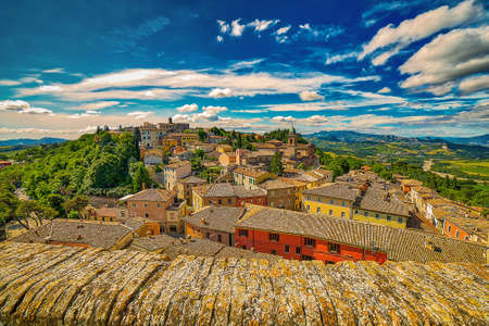 view of Italian medieval village on hilly countryside