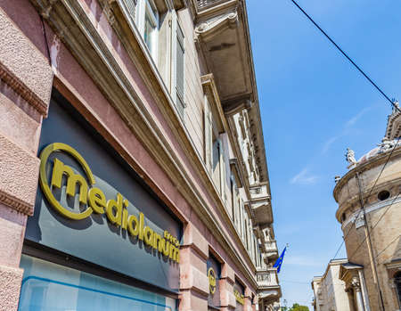 PARMA, ITALY – AUGUST 23, 2018: Dust and dirt cover the sign of the Mediolanum agency