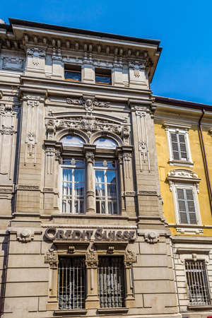 PARMA, ITALY – AUGUST 23, 2018: Dust and dirt cover the sign of the Credit Suisse agency