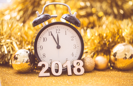 Photo pour Vintage clock at midnight to happy new year 2018 - image libre de droit