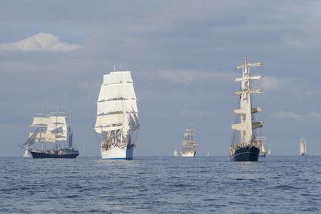 Several tall ships in a row before start a regatta