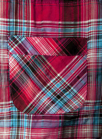 Pocket of a  red checked shirt, close-up
