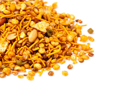 Photo pour Pile of dry roasted Indian snack mix, isolated over white - image libre de droit