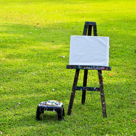 whiteboard on the green grass