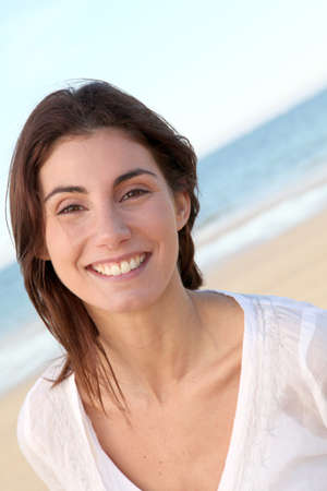 Portrait of beautiful smiling woman at the beach
