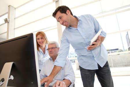 Senior people attending business training