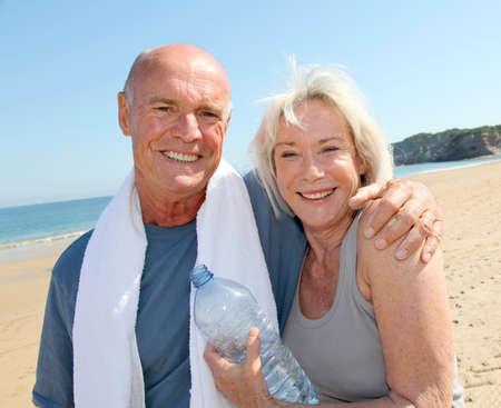 Portrait of athletic senior couple on the beach