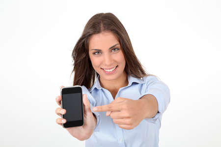 Portrait of beautiful young woman holding smartphone