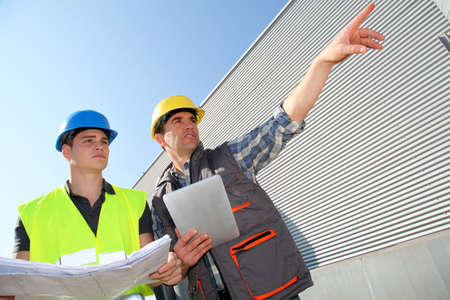 Young people in professional training on industrial site