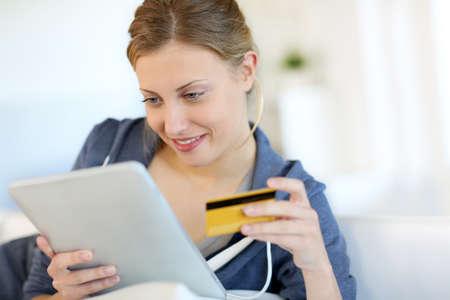 Closeup of beautiful blond girl doing online shopping