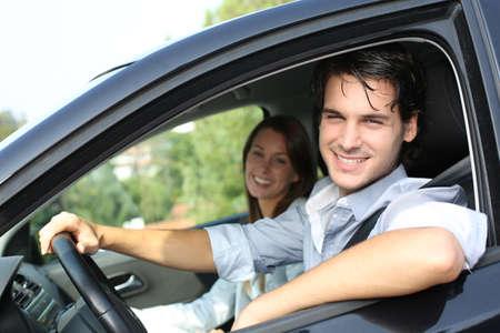 Cheerful couple driving car