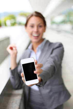 Closeup of smartphone screen hold by businesswoman