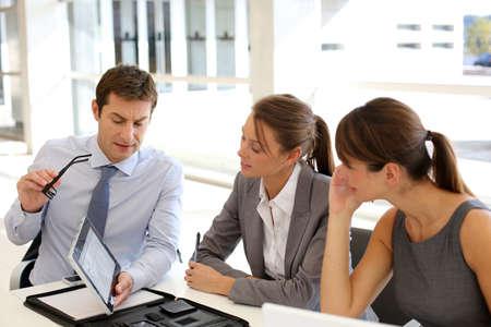 Business presentation around table