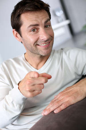 Man pointing finger towards camera