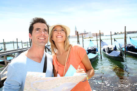 Tourists looking at map in front of San Giorgio Maggiore Island, Venice