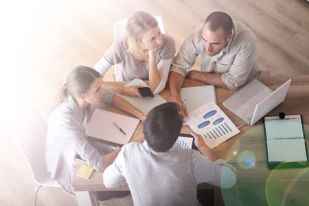 Upper view of business people around table