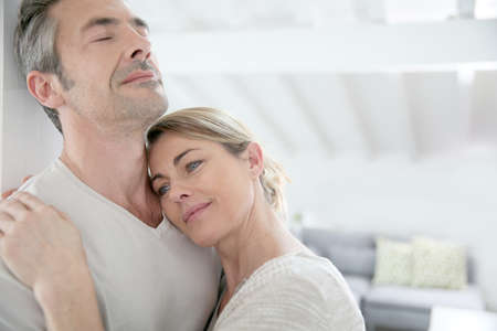 Mature couple embracing with love and tenderness