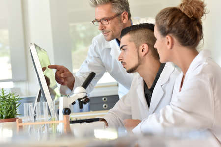 Students in biology attending training with microbiologist