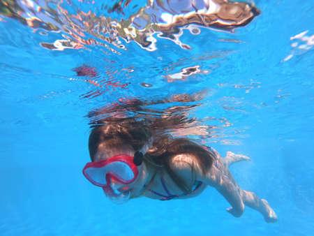 Little girl snorkeling in pool