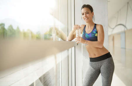 Fitness brunette girl relaxing after exercising