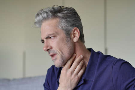 Photo for Mature man with sore throat at home - Royalty Free Image