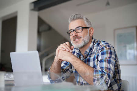 Photo for Man working from home on laptop computer - Royalty Free Image