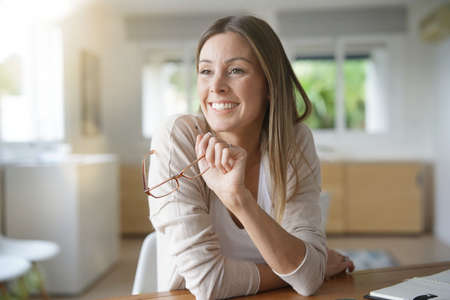 Photo for Cheerful woman working from home - Royalty Free Image