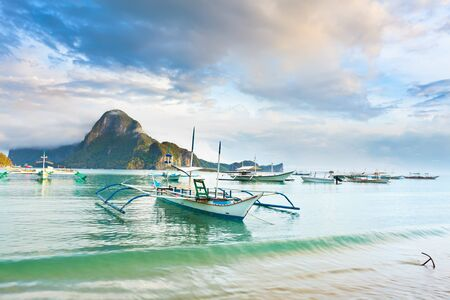 Traditional philippine boats bangka in tropical lagoon