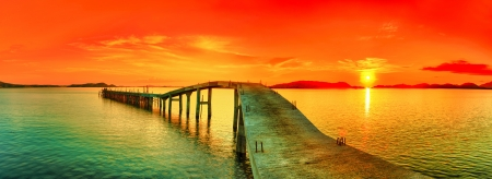 Photo pour Sunset over the sea. Pier on the foreground. Panorama - image libre de droit