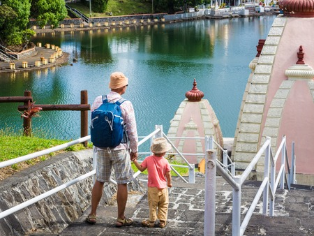 Father and child at Ganga Talao temple. Mauritius.