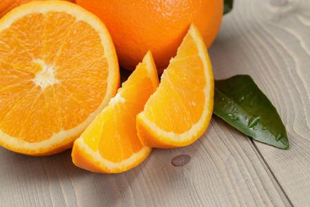 ripe spanish oranges on wood table, rustic photo
