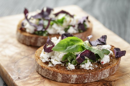 rye sandwich or bruschetta with ricotta, herbs and basil