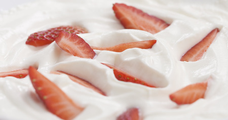 fresh sliced straberries in cream background, 4k photo