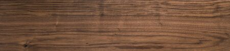 Foto de Black walnut wood texture of solid board oil finished - Imagen libre de derechos