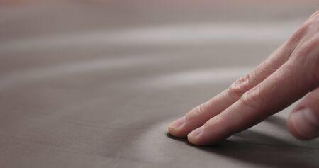 Photo pour man hand checking brown leather piece closeup, wide photo - image libre de droit