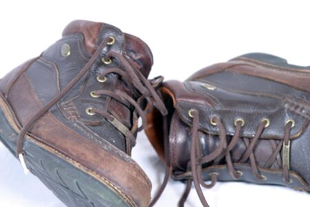 pair of worn brown rugged work boots