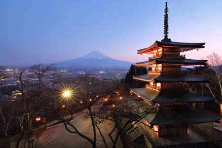 Beautiful scenery during twilight of Mountain Fuji with Chureito Pagoda(red pagoda) at Arakurayama Sengen Park in Japan. This is a very popular for tourists. Religion and Attraction Concept