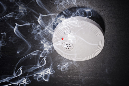 Smoke detector in the smoke of a fire
