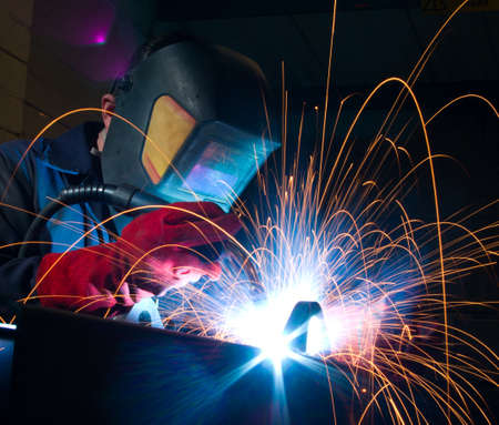 Close up of arc welding in manufacturing plant