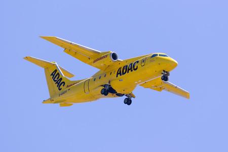 Luqa, Malta 18  July 2016: ADAC Luftrettung (Aero-Dienst) Fairchild Dornier 328JET air ambulance jet on long finals for runway 31 in the harsh midday July sun.
