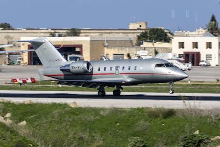 Luqa, Malta - November 12, 2018: VistaJet Bombardier Challenger 605 (CL-600-2B16) (REG: 9H-VFC) landing runway 13.