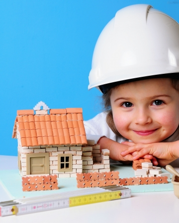 Photo for Little girl and house under construction - Royalty Free Image