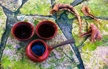 Black Chinese Tea place on the ground of Autumn garden
