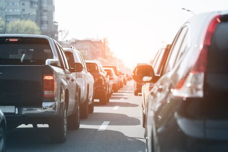 Photo for Evening traffic jam on busy city highway. Rows of car stck on road due to crush accident. Sunset metropolis rush hour scene. - Royalty Free Image